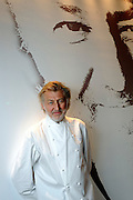 French chef Pierre Gagnaire poses with a glass of wine at his restaurant in Tokyo, Japan. .Photographer: Robert Gilhooly