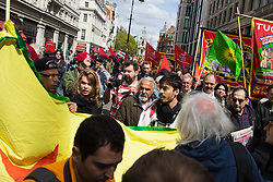 London, May 1st 2015. Hundreds of workers and Trade Unionists from across the UK are joined by Turks, Kurds and anti-capitalists as they march through London on May Day. PICTURED: Flags and banners sway on The Strand as the march heads towards Trafalgar Square.