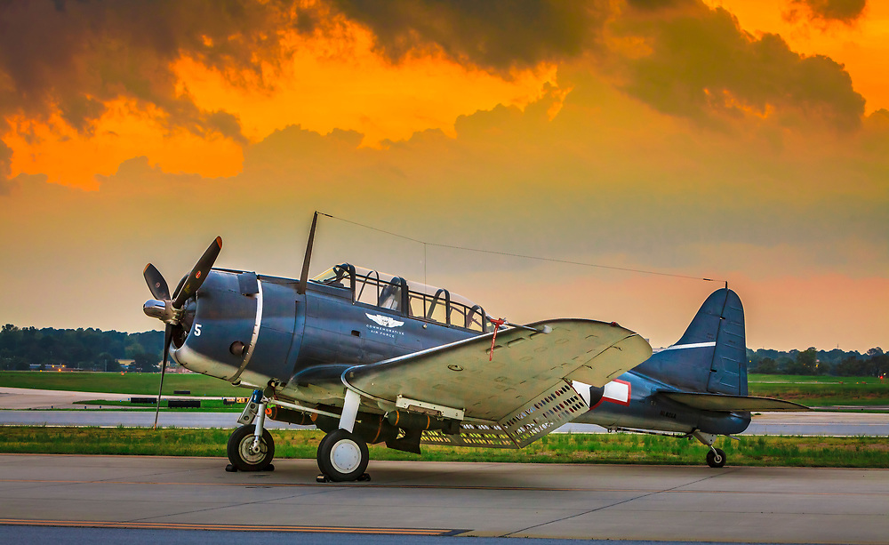 "SBD-5 ""Dauntless"" Dive Bomber, operated by the Dixie Wing of the Commemorative Air Force.  Dekalb Peachtree Airport (PDK), Atlanta.  Created by aviation photographer John Slemp of Aerographs Aviation Photography. Clients include Goodyear Aviation Tires, Phillips 66 Aviation Fuels, Smithsonian Air & Space magazine, and The Lindbergh Foundation.  Specialising in high end commercial aviation photography and the supply of aviation stock photography for commercial and marketing use."