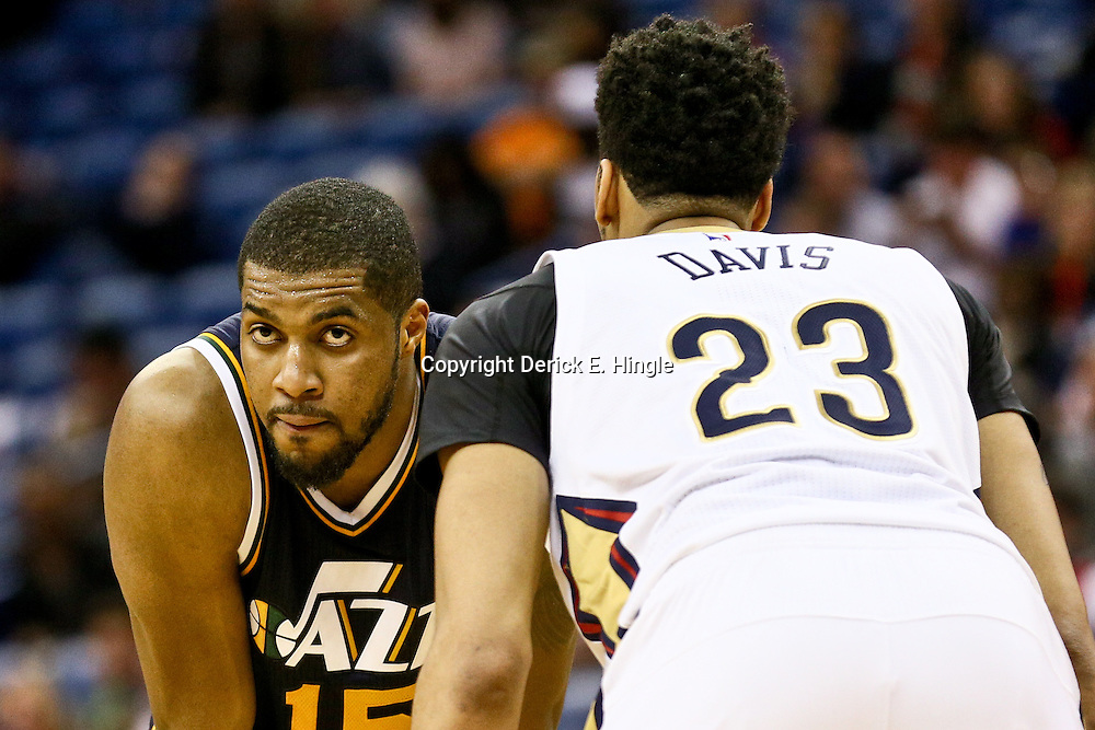 Feb 10, 2016; New Orleans, LA, USA; Utah Jazz forward Derrick Favors (15) and New Orleans Pelicans forward Anthony Davis (23) during the fourth quarter of a game at the Smoothie King Center. The Pelicans defeated the Jazz 100-96. Mandatory Credit: Derick E. Hingle-USA TODAY Sports