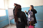 An Egyptians  woman is asked to lift her Niqab to show her face to a female election worker before she could vote at a polling station in the El Mokattam neighborhood of  Cairo , Egypt May 23, 2012. Egyptians head to the polling stations throughout Egypt  Wednesday for an historic opportunity in which they will for the first time to pick their president in a wide open election that pits Islamists against men who served under deposed leader Hosni Mubarak.(Photo by Heidi Levine/Sipa Press).