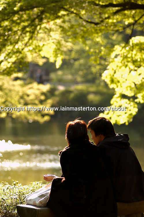 Japanese young couple in famous Korakuen park in central Tokyo