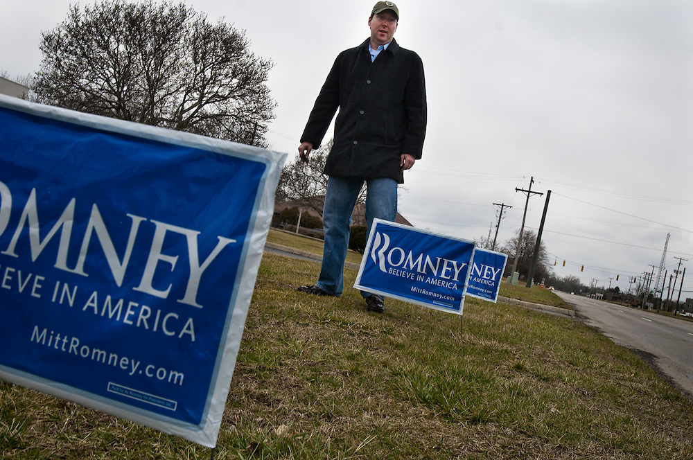 Ohio Primary Elections, Columbus, Oh.. Mike Hanna, putting up yard signs outside Mitt Romney's campaign office in Columbus OH. Mike who lives in Florida, came to Ohio to volunteer for the Mitt Romney campaign.