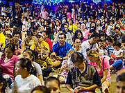 """23 DECEMBER 2018 - CHANTABURI, THAILAND: Part of the crowd at the Cathedral of the Immaculate Conception's Christmas Fair in Chantaburi. Cathedral of the Immaculate Conception is holding its annual Christmas festival, this year called """"Sweet Christmas @ Chantaburi 2018"""". The Cathedral is the largest Catholic church in Thailand and was founded more than 300 years ago by Vietnamese Catholics who settled in Thailand, then Siam.  PHOTO BY JACK KURTZ"""