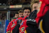 PENTICTON, CANADA - SEPTEMBER 17: Dillon Dube #59 of Calgary Flames stands on the bench for the national anthem against the Edmonton Oilers on September 17, 2016 at the South Okanagan Event Centre in Penticton, British Columbia, Canada.  (Photo by Marissa Baecker/Shoot the Breeze)  *** Local Caption *** Dillon Dube;