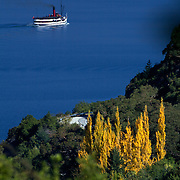 The TSS Earnslaw,  a 1912 Edwardian vintage twin screw steamer on the waters of Lake Wakatipu in, Queenstown, New Zealand. .It is one of the oldest tourist attractions in Central Otago, and the only remaining passenger-carrying coal-fired steamship in the southern hemisphere..The TSS Earnslaw heads along Lake Wakatipu from Queenstown  daily, running tourist trips to Walter Peak Station passing magnificent  peaks and contrasting shoreline foliage along the lakeside. Queenstown, New Zealand. 9th April 2011. Photo Tim Clayton