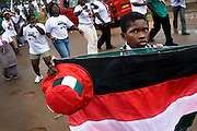 A boy tries to sell items in the colors of the National Democratic Congress (NDC), Ghana's official opposition party, during a rally in Tema, roughly 30km east of Ghana's capital Accra on Friday December 5, 2008. Ghanaians are voting in a presidential election on December 7 as incumbent John Agyekum Kufuor, leader of the New Patriotic Party (NPP),  is to step down after ruling for 2 consecutive 4-year terms.