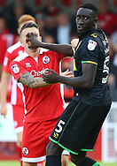 Bevis Mugabi of Yeovil fends off  Dean Cox of Crawley during the Sky Bet League 2 match between Crawley Town and Yeovil Town at the Checkatrade Stadium in Crawley. 02 Sep 2017