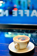 latte cup with foam by the window