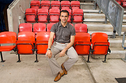 WIGAN, ENGLAND - Monday, August 24, 2009: Wigan Athletic's manager Roberto Martinez sits on the 'bench' in the technical area at the club's DW Stadium. (Photo by David Rawcliffe/Propaganda)