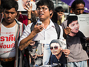 07 JULY 2015 - BANGKOK, THAILAND: Student activists rally at the Ministry of Defense in support of the 14 students arrested by the military. About 100 people gathered in front of the Ministry of Defense in Bangkok Tuesday to support 14 university students arrested two weeks ago for violating orders against political assembly. They're facing criminal trial in military courts. The courts ordered their release Tuesday because they can only be held for two weeks without trial, the two weeks expired Tuesday and the military court chose not to renew their pretrial detention. The court order was not an acquittal. They still face trial and possible prison sentences if convicted.        PHOTO BY JACK KURTZ