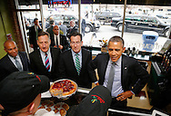 U.S. President Barack Obama arrives for lunch with Massachusetts Governor Deval Patrick (D-MA) (FROM L), Vermont Governor Peter Shumlin (D-VT) and Connecticut Governor Dannel Malloy (D-CT) at the Café Beauregard restaurant in New Britain, Connecticut March 5, 2014.