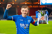 Rangers captain Daniel Finlayson (#5) holds aloft the trophy after Rangers win the Scottish FA Youth Cup Final match between Celtic and Rangers at Hampden Park, Glasgow, United Kingdom on 25 April 2019.