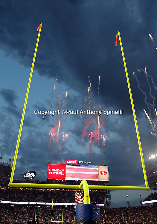 Fireworks go off in the background as they framed by one of the end zone goal posts before the San Francisco 49ers 2015 NFL week 1 regular season football game against the Minnesota Vikings on Monday, Sept. 14, 2015 in Santa Clara, Calif. The 49ers won the game 20-3. (©Paul Anthony Spinelli)