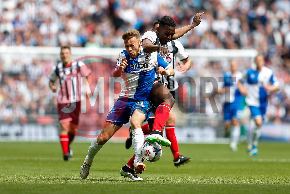 Matt Taylor of Bristol Rovers and Aristote Nsiala of Grimsby Town compete for the ball - Photo mandatory by-line: Rogan Thomson/JMP - 07966 386802 - 17/05/2015 - SPORT - FOOTBALL - London, England - Wembley Stadium - Bristol Rovers v Frimsby Town - Vanarama Conference Premier Play-off Final.
