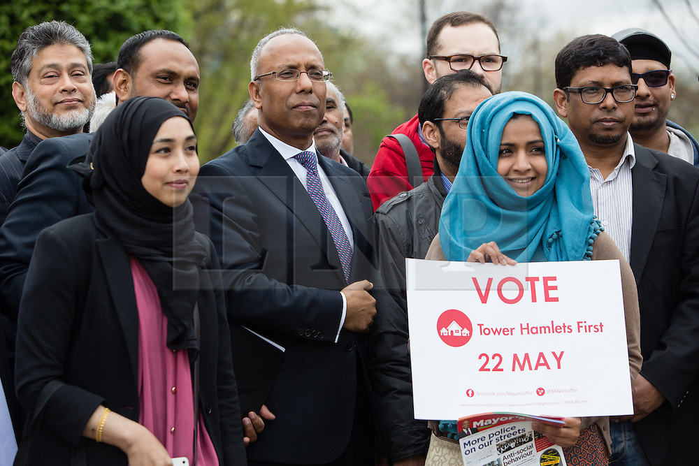 "© Licensed to London News Pictures. 05/04/2014. London, UK. Mayor of Tower Hamlets, Lutfur Rahman (centre) and supporters from the Tower Hamlets First party take part in a community walkabout in Stepney, East London on 5th April 2014 to canvas for the upcoming Mayoral election. Communities Secretary, Eric Pickles yesterday sent inspectors to start an audit of Tower Hamlets council and the Rahman administration following allegations of fraud and financial mismanagement, also reported by BBC's Panorama programme this week. Mayor Lutfur Rahman denies all allegations, which he calls ""Panorama lies"". Photo credit : Vickie Flores/LNP"
