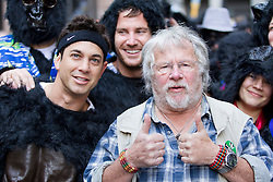 © Licensed to London News Pictures. 22/09/2012. LONDON, UK. Naturalist and comedian Bill Oddie (R) and Australian actor and dancer Adam Garcia pose with runners at the start-line of the 2012 Great Gorilla Run in London today (22/09/12). Now in its 10th year, the annual event sees hundreds of competitors take part in a 7km fun-run dressed as gorillas to raise money for mountain gorilla conservation projects in Africa. Photo credit: Matt Cetti-Roberts/LNP