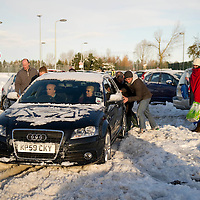 Snow and Ice In Perthshire....29.11.10<br /> Stranded motorists from the A9 and the M90 pictured trying to leave, but getting stuck in the snow and ice, Perth's North Inch Community Campus where they have been since being rescued during Sunday night. The Campus in Perth gave shelter to some 600 stranded motorists overnight.<br /> Picture by Graeme Hart.<br /> Copyright Perthshire Picture Agency<br /> Tel: 01738 623350  Mobile: 07990 594431