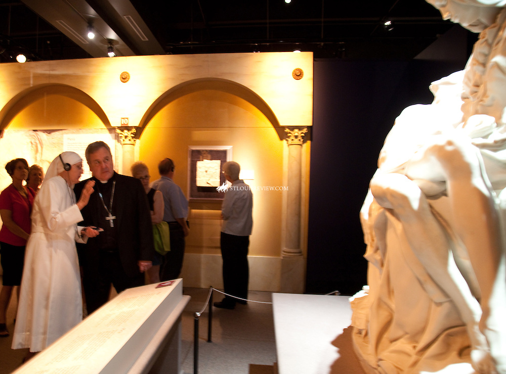 Archbishop Robert J. Carlson spoke with Sister Marie Joseph, LSP, during a special event for religious July 7 at the Vatican Splendors Exhibit at the Missouri History Museum. Archbishop Carlson and Sister Marie Joseph were looking at a reproduction of La Pieta, which Michelangelo sculpted in 1499.