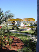 Spruce Creek where everybody Owns An Airplane<br /> <br /> Aside from an occasional Boeing, Spruce Creek's aircrafts consist of a stunning collection of Cessnas and Pipers, a P-51 Mustang, several L-39 Albatros, an Eclipse 500, a French Fouga Magister and even one Russian MiG-15 fighter jet. In addition to all the airplanes and golf cars, you'll see Lamborghinis, Corvettes, motorcycles of every description and even a Porsche GT2.<br /> <br /> The people of Spruce Creek live in a tightly knit community. Most of them are professional pilots and they talk in aviation jargon. Others are doctors, lawyers and land speculators, but all of them are, without exception, nuts about aviation. Every Saturday morning, some of them would gather beside the runway, take off in groups of three and fly to one of the local airports for breakfast – a tradition they call the Saturday Morning Gaggle.<br /> <br /> But Spruce Creek isn't the only residential airpark in the country. The concept first developed after World War II, a time period when the United States had an incredible surplus of both airfields and pilots, created by the war, whose population had ballooned from fewer than 34,000 in 1939 to more than 400,000 by 1946. In order to put countless deactivated military strips across the nation to good use and to accommodate the burgeoning pilot population, the Civil Aeronautics Administration proposed the construction of 6,000 residential airparks throughout the country. While that number was never fulfilled, the initial proposal generated enough momentum to pave the way for decades' worth of interest and investment in what has become a large and active network of fly-in communities.<br /> <br /> Today, there are more than 600 fly-in communities in the United States, with the heaviest concentration in Arizona, Colorado, Florida, Texas and Washington. Spruce Creek is the largest fly-in community. The aviation lifestyle has even spread internationally to Canada, South Africa and Costa Rica<br /> <br /> Spruce Creek, in Northeast Flori