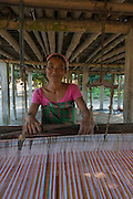Mising weaving silk cloth<br /> Mising Tribe (Mishing or Miri Tribe)<br /> Majuli Island, Brahmaputra River<br /> Largest river island in India<br /> Assam,  ne India