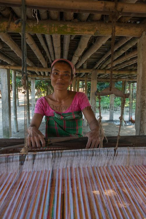 Mising weaving silk cloth<br /> Mising Tribe (Mishing or Miri Tribe)<br /> Majuli Island, Brahmaputra River<br /> Largest river island in India<br /> Assam,  ne India