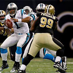 January 1, 2012; New Orleans, LA, USA; New Orleans Saints defensive end Will Smith (91) pressures Carolina Panthers quarterback Cam Newton (1) during the first quarter of a game at the Mercedes-Benz Superdome. Mandatory Credit: Derick E. Hingle-US PRESSWIRE