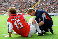 Ray Parlour is tended to by Arsenal physio Gary Lewin. Bradford City 1:1 Arsenal, F.A. Carling Premiership, 9/9/2000. Credit Colorsport / Stuart MacFarlane.