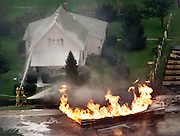 09-14-00 // Firefighters try to save a home by dousing it with water while a tanker truck burns on SR 36 just east of SR 231 Thursday afternoon. (Mike Fender Photo from WTHR Chopper 13) w/ story  file 52165