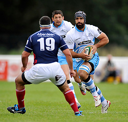 Josh Strauss (Glasgow Warriors) takes on the London Scottish defence - Photo mandatory by-line: Patrick Khachfe/JMP - Mobile: 07966 386802 30/08/2014 - SPORT - RUGBY UNION - London - Richmond Athletic Ground - London Scottish v Glasgow Warriors - Pre-Season Friendly