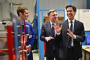 © Licensed to London News Pictures. 14/02/2013. Bedford, UK. Ed Miliband (right) and Ed Balls (centre) talk to an apprentice. Ed Miliband MP, Leader of the Labour Party, delivers a major speech at Bedford Training Group in Bedford today, 14th February 2013. In the speech he set out a 'One Nation Labour agenda for rebuilding Britain's economy'. The speech was followed by a Q&A session with Ed Balls, Shadow Chancellor and a tour of the training facility. Photo credit : Stephen Simpson/LNP