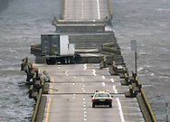 A bridge over Escambia Bay north of Pensacola, Florida is cut in two by Hurricane Ivan with a tractor-trailer rig swallowed by the gap September 16, 2004.   REUTERS/Rick Wilking