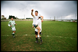 Podes, Asturias, Spain<br /> Players celebrating a goal in the field.<br /> &copy;Carmen Secanella.