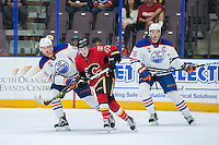 PENTICTON, CANADA - SEPTEMBER 17: Matt Benning #83 and Ben Betker #76 of Edmonton Oilers check Matthew Phillips #47 of Calgary Flames on September 17, 2016 at the South Okanagan Event Centre in Penticton, British Columbia, Canada.  (Photo by Marissa Baecker/Shoot the Breeze)  *** Local Caption *** Matt Benning; Ben Betker; Matthew Phillips;