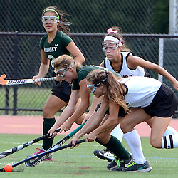 Ridley's Kaley Malampy (21) and Radnor's Katie Jordan (1) fight for possession of the ball as Ridley's Lauren Calleung (2) and Radnor's Tara Lewandowski (2) look on during the Radnor at Ridley field hockey game, Thursday afternoon September 11, 2014. (Times staff / TOM KELLY IV)