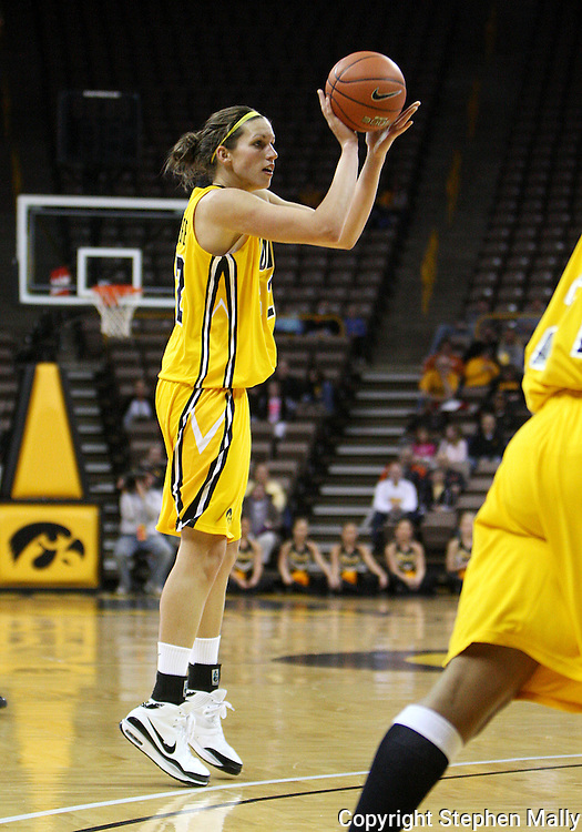 26 JANUARY 2009: Iowa forward Wendy Ausdemore (32) puts up a three point shot during the first half of an NCAA women's college basketball game Monday, Jan. 26, 2009, at Carver-Hawkeye Arena in Iowa City, Iowa. Iowa defeated Michigan 77-69.