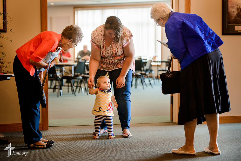 Jeannine Heiden (left) and Betty Renken greet Braelynn Dempcy and her mother Heather following fellowship on Sunday, Sept. 24, 2017, at Faith Lutheran Church, York, Neb. LCMS Communications/Erik M. Lunsford