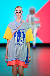"© Licensed to London News Pictures. 05/06/2019. LONDON, UK.  A model presents a look by Steph Starkey from Northumbria University during the ""Best of GFW"" show on the final day of Graduate Fashion Week.  Taking place at the Old Truman Brewery in East London, the event presents the graduation show of up and coming fashion designers from UK and international universities.  Photo credit: Stephen Chung/LNP"