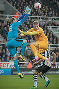 Matz Sels (Newcastle United) punches the ball clear from Simon Makienok (Preston North End) during the EFL Cup 4th round match between Newcastle United and Preston North End at St. James's Park, Newcastle, England on 25 October 2016. Photo by Mark P Doherty.