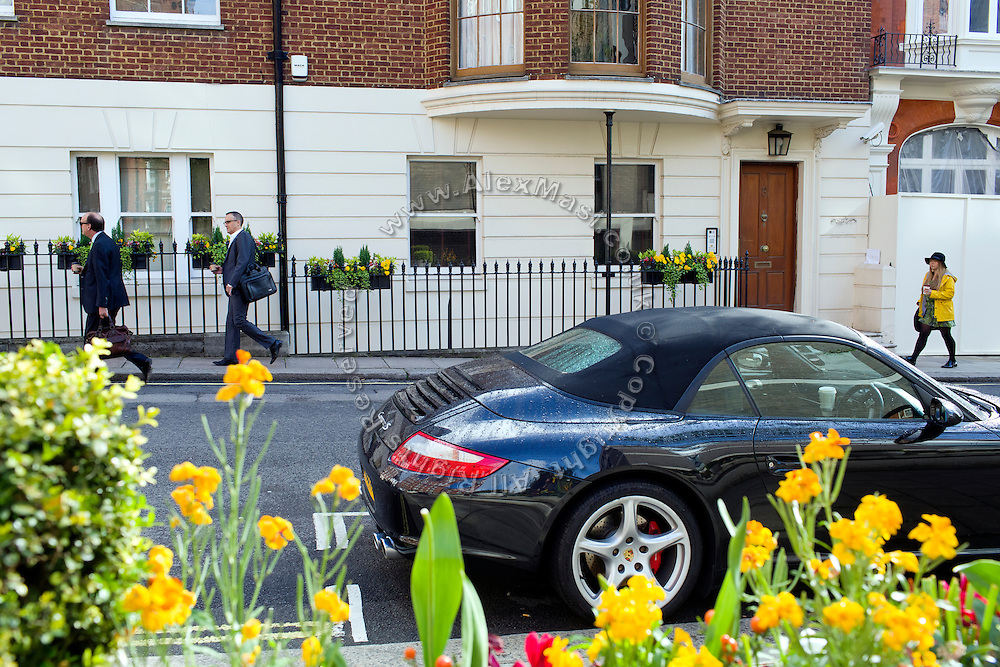 Two men and a woman are walking past  8 Chesterfield Hill, (Mercantile Group HQ) in central London, United Kingdom.<br /> <br /> CREDIT: Alex Masi for The Wall Street Journal<br /> CHESTERTON<br /> <br /> The name of London real-estate agency Chesterton Humberts exudes English affluence. But in early 2011, as Libya was engulfed in revolution, a substantial stake in the firm was quietly acquired by the wealthy family of a longtime lieutenant to Moammar Gadhafi, according to a person with direct knowledge of the investment.
