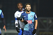 Wycombe Wanderers striker Scott Kashket (11) watches the ball with Tranmere Rovers forward (on loan from Aston Villa) Rushian Hepburn-Murphy (18) during the The FA Cup match between Wycombe Wanderers and Tranmere Rovers at Adams Park, High Wycombe, England on 20 November 2019.