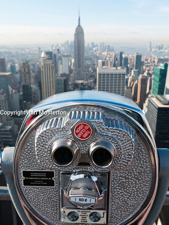 Public pay viewing coin operated binoculars on Top of The Rock observation platform  at Rockefeller Center in Manhattan New YorkCity