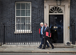 © Licensed to London News Pictures. 10/10/2017. Foreign Secretary Boris Johnson (L) and Trade Secretary Liam Fox leave Number 10 Downing Street after attending the weekly cabinet meeting. London, UK. Photo credit: Peter Macdiarmid/LNP