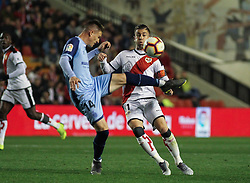 March 1, 2019 - Madrid, Madrid, Spain - Embarba of Rayo Vallecano and Raul C. of Girona in action during La Liga Spanish championship, , football match between Rayo Vallecano and Girona , March 01th, in Estadio de Vallecas in Madrid, Spain. (Credit Image: © AFP7 via ZUMA Wire)