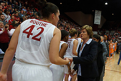 Dec 20, 2011; Stanford CA, USA;  Tennessee Lady Volunteers head coach Pat Summitt (right) shakes hands with Stanford Cardinal forward/center Sarah Boothe (42) during the second half at Maples Pavilion.  Stanford defeated Tennessee 97-80. Mandatory Credit: Jason O. Watson-US PRESSWIRE