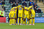 AFC Wimbledon players huddle before the EFL Sky Bet League 1 match between Plymouth Argyle and AFC Wimbledon at Home Park, Plymouth, England on 6 October 2018.