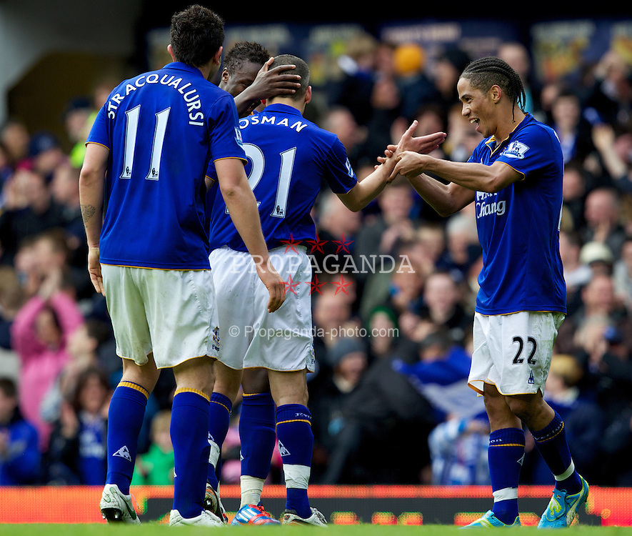 LIVERPOOL, ENGLAND - Easter Monday, April 9, 2012: Everton's Leon Osman celebrates scoring the third goal against Sunderland with team-mates, and fellow goal scores on the day, Magaye Gueye and Steven Pienaar during the Premiership match at Goodison Park. (Pic by Vegard Grott/Propaganda)