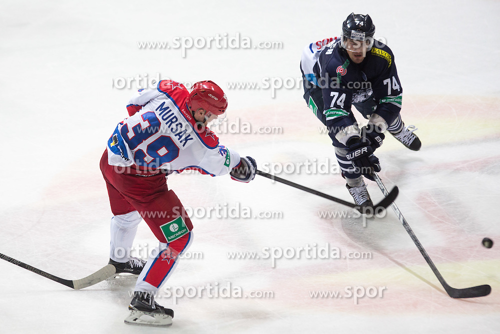 Jan Mursak of CSKA Moscow shoots while Nathan Perkovich of KHL Medvescak Zagreb tries to block the shot during KHL League ice hockey match between KHL Medvescak Zagreb and CSKA Moscow, on September 18, 2014 in Dvorana Sportova, Zagreb, Croatia. (Photo By Matic Klansek Velej / Sportida)