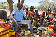 Grevy's Zebra Community Education in Laresoro Village<br /> Peter Lalampaa eduates Samburu villagers about Grevy's zebras<br /> Near Kalama Conservancy, Northern Kenya, East Africa