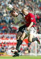Liverpool's Jamie Carragher and Manchester United's Mickael Silvestre during the Premiership match at Old Trafford, Manchester, Saturday, March 5th, 2003.<br /><br />Pic by David Rawcliffe/Propaganda<br /><br />Any problems call David Rawcliffe +44(0)7973 14 2020 david@propaganda-photo.com http://www.propaganda-photo.com